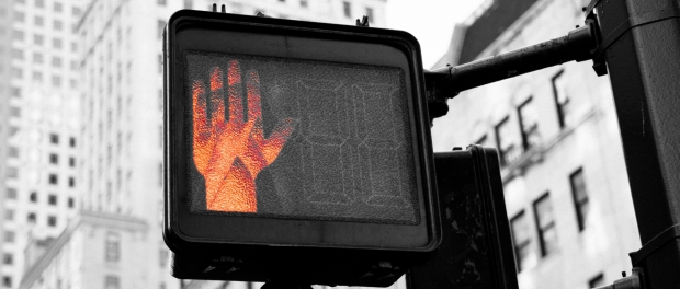 Red hand on city crosswalk sign