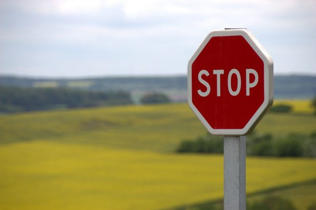 Red stop sign in a country field