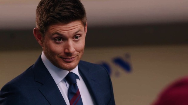 Dean Winchester with a happy look on his face