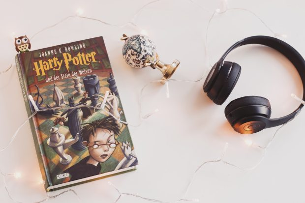 Harry Potter book in German with headphones and toys